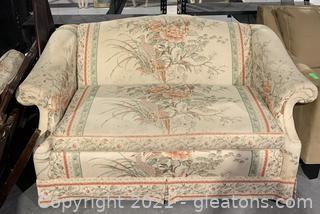 Upholstered Camelback Loveseat