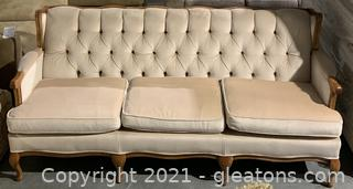 Tufted Pale Pink Sofa with Wood Detail