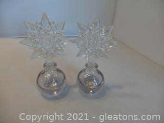 TWO IRICE PERFUME BOTTLES WITH SNOWFLAKE TOPPERS