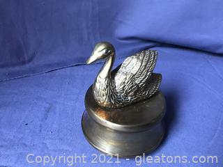 Vintage brass swan music box