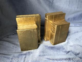 Gold colored book ends