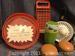 Kitchen helpers, popcorn popper, slider press, juicer salt and pepper, celery dip and go
