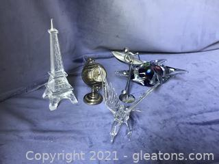 Desk top, world clock, paper weights, crystal eagle, man in boat