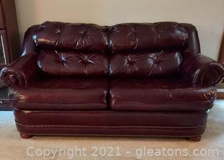 Stylish Broyhill Burgundy 2 Cushion Leather Sofa with Nailhead Trim