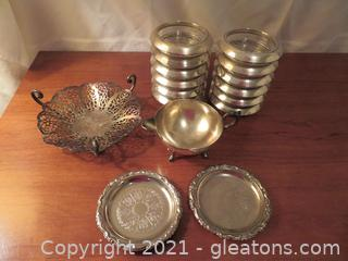 Twelve Glass and Silver Rimmed Coasters, Two Silver Coasters, Silver Dish and Creamer