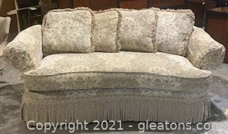Taylor King Upholstered Sofa with Fringed Skirt