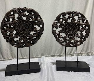 Two Medallion Sculptures on Stands