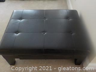 Black Pleather Ottoman Wide Side Drawer by Ashley Furniture