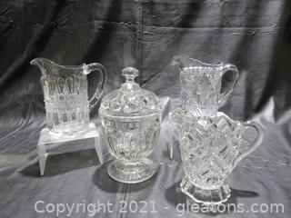 Three Cut Glass Pitchers and Covered Candy Dish