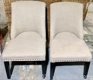 A Pair of Taupe Dining Chairs with Nailhead Trim