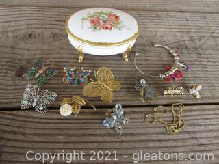 Porcelain Handpainted Trinket Box With Costume Butterflies Brooches and Other Costume pieces