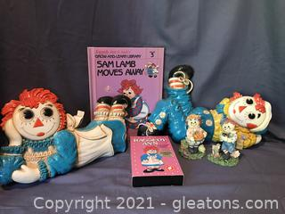 Vintage 1970's Syrco Plaques of Raggedy Ann and Andy, book, VHS tape, 2 figurines