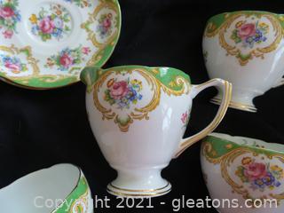 "Lot (7) Piece tea cups and saucer with creamer Grafton China England "" Cheltenham'"