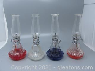 Group of Four Pressed Glass Oil Lamps- With