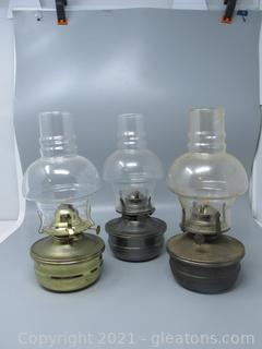 Lot of Three Metal Based Oil Lamps With Unique Glass Chimneys