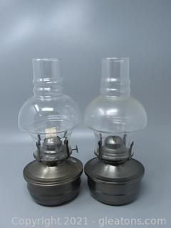 Two Handsome Metal Based Oil Lamps