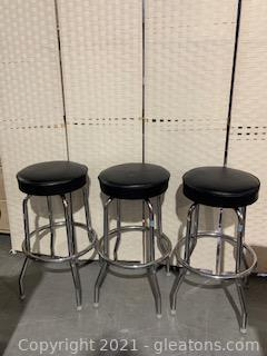 Three Metal Bar Stools with Black Seats