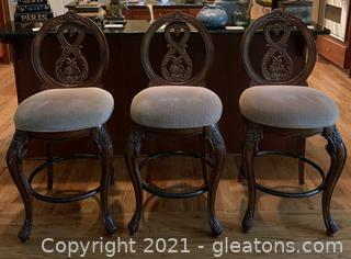 Three Carved and Plush Bar Stools