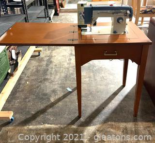 White ZigZag Stitcher Sewing Machine in Cabinet