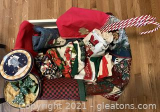 A Bin of Christmas Table Cloths Runners, Place Mat, Napkins & More