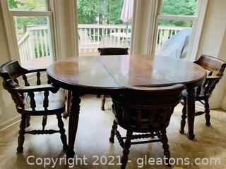 Thomasville Oval Dining Table with 4 Captains Tavern Chairs