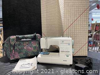 Kenmore sewing machine (model 385) with accessories