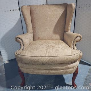 Lovely Peach Colored Wingback Chair with Nail Head Trim