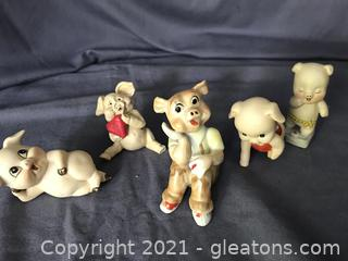 Five little pigs, one made of clay one vintage from japan
