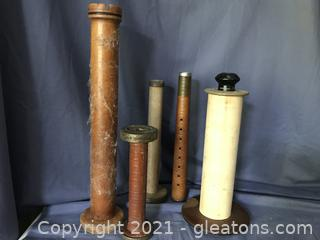 Old wooden spools all sizes