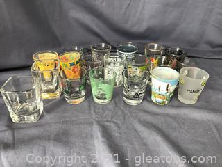 19 advertising and souvenir shot glasses