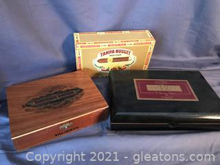 Three Cigar boxes, two wooden one vintage Tampa Nugget