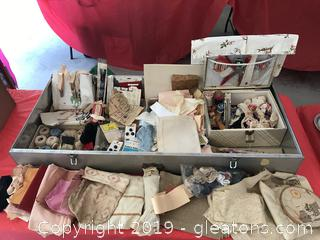 Large aluminum box full of vintage sewing items, old garter hooks, snaps etc.