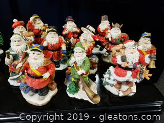 Lot 31 Set Of (12) Vintage Collectible Resin Santa Statues