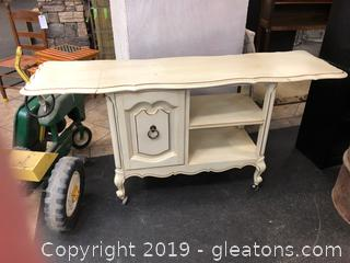 Small Rolling Buffet/Server On Caster Wheels With Folding Ends Beautiful Pale Yellow With Gold Accent