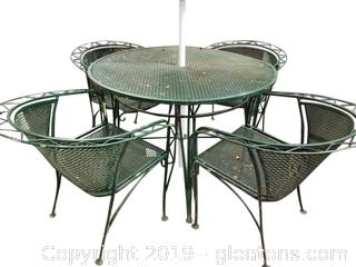 Heaving Round Vtg. (A) Wrought Iron Table And (4) Chairs And Umbrella