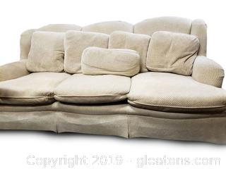 Oversized Cream Sofa With Lots Of Matching Pillows