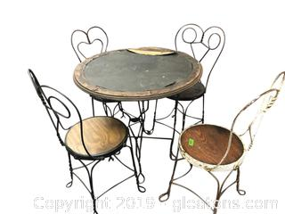 Antique Patio Table With 3 Chairs Wrought Iron And Wood.
