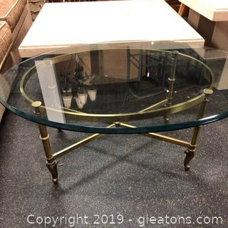 Vintage Hollywood Mid Century Oval brass And Glass Coffee Table
