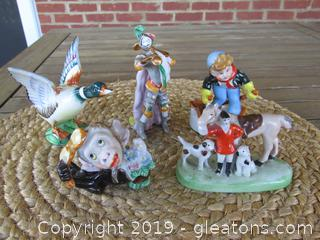 Lot of 5 Made in Japan Figurines / Boy on Skis / Renaissance Trumpet Blower / Mallard Duck / Huntsman / Chimpanzee