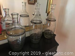 lot of three galss bottles with wire metal