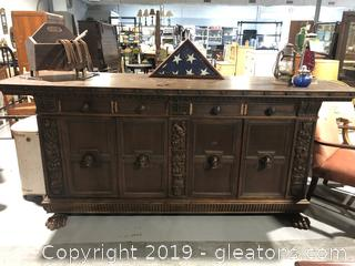 Antique North Wind Faces and Paw Foot Sideboard