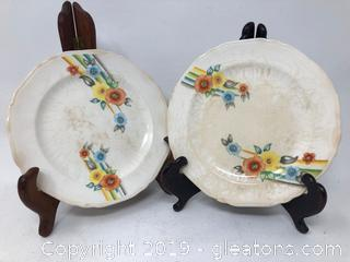 Two Union Made by Crown Potteries Saucers