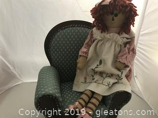 Raggedy Ann Doll in beautiful upholstered Chair