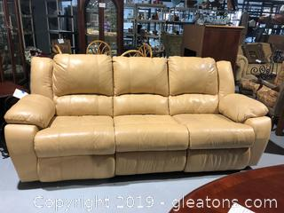 Tan Leather Sofa W/3 Cushions and Wide Arms.   Reclines