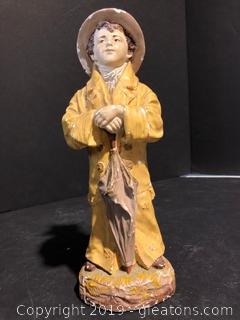 Figurine:  Boy on a Rainy Day