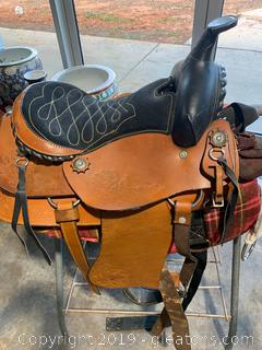 High End Pony Saddle with a Stand and Plaid Pad