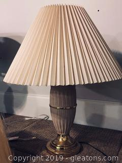 Tan Ceramic Lamp W/Shiny Brass Base and a Pleated Shade