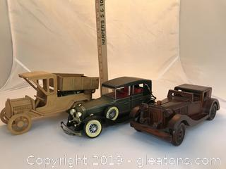 Three cars,  two wooden and an old sedan radio car