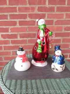 3 Snowman 1 Large Ceramic Snowman Carrying a Tree (has a space to put a Votive in Back) 2 Snowman Candles