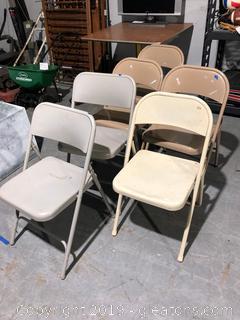 Six Metal Folding Chairs